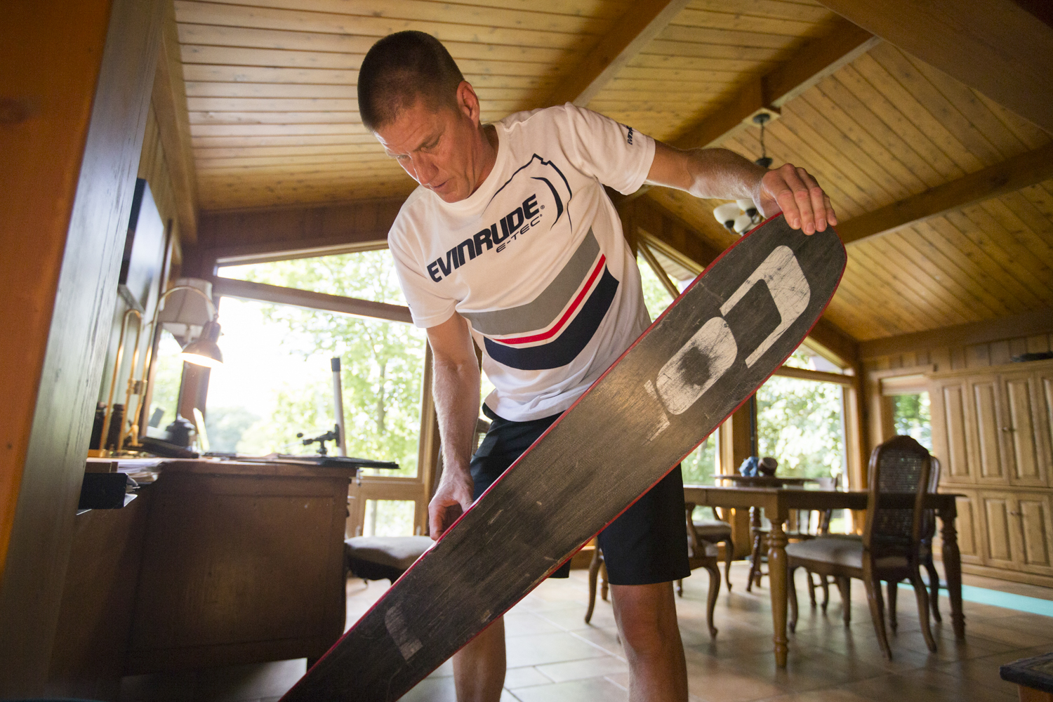 Randy Seerup shows how he saves broken skis so he can reshape them into different, smaller style of ski on Friday, Aug. 17, 2018, at his home in Machesney Park. The Seerup family is heavily involved with the Ski Broncs. Wendy Seerup, Randy's wife, sometimes manages show schedules and rosters. Their son, Brandon, is the 2018 season's show director, and the couple's 12-year-old daughter, Jada, can often be found high up on a multi-tier formation. [SCOTT P. YATES/RRSTAR.COM STAFF]