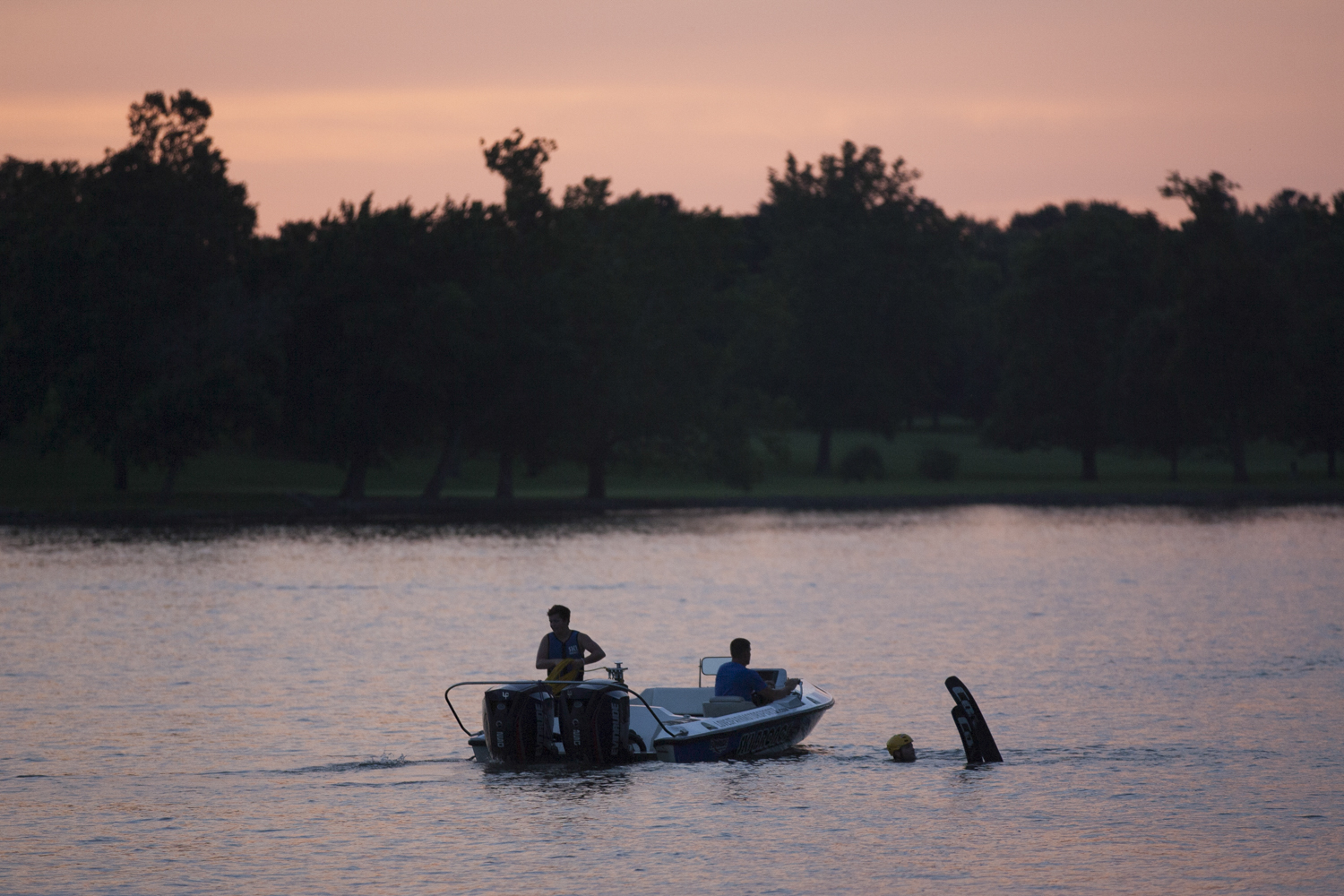 A skier and a boat driver coordinate their next practice run as the sun sets on Tuesday, July 31, 2018. [SCOTT P. YATES/RRSTAR.COM STAFF]