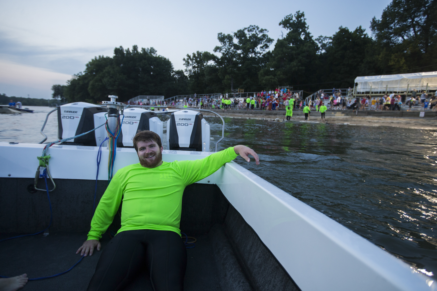 Jay Carlstrom relaxes in the back of a boat while retrieving a Ski Bronc dock down river after the evening's show. [SCOTT P. YATES/RRSTAR.COM STAFF]