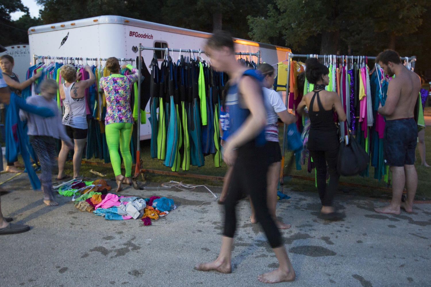 Costumes hang from a long clothes rack behind the concession stand. It is a hive of activity behind the storage area while the team packs up equipment after each show. [SCOTT P. YATES/RRSTAR.COM STAFF]
