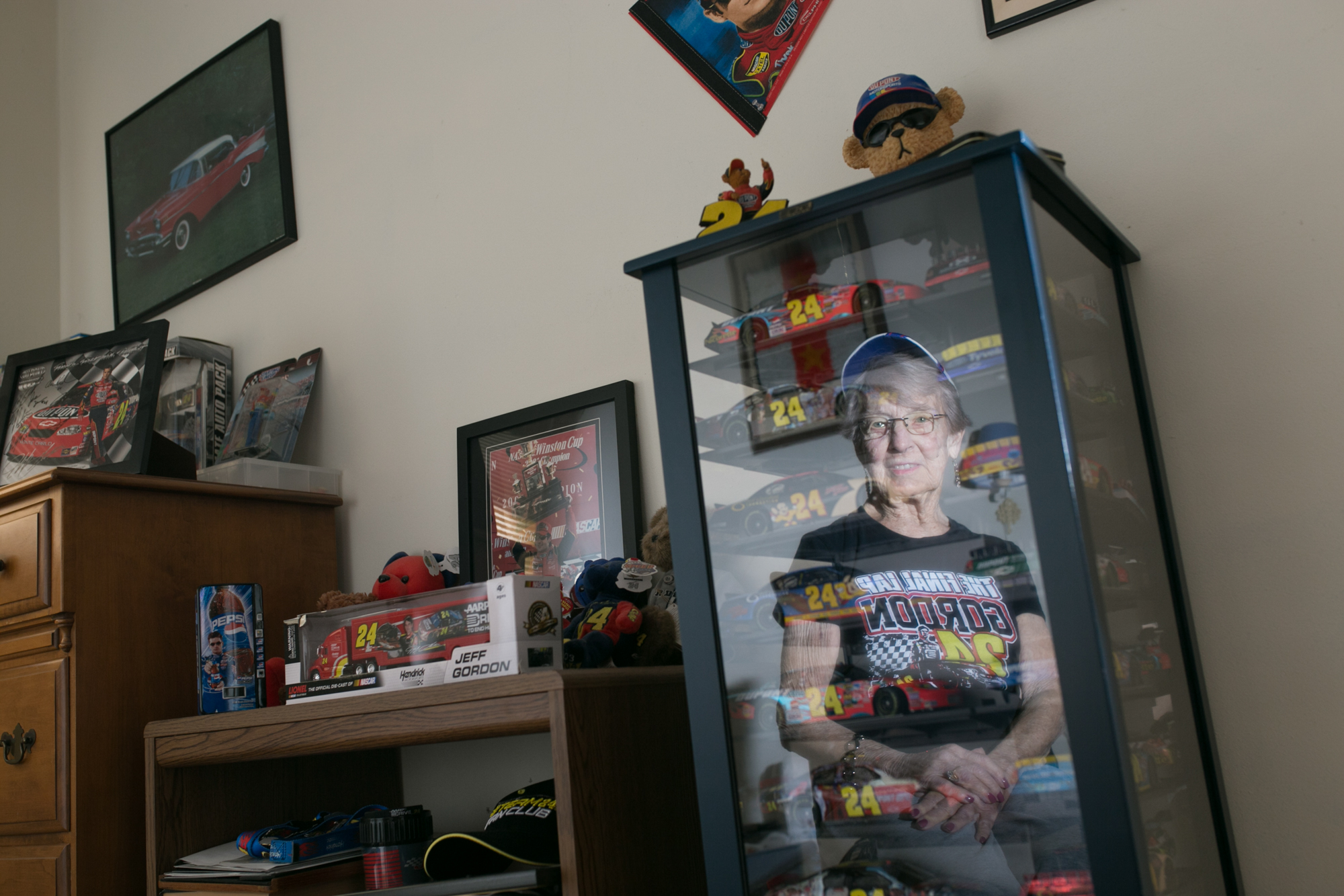 "Cathy Adams of Rockford sits for a portrait in her ""Jeff Gordon room"" where she keeps a wall full of her favorite NASCAR driver's memorabilia on Tuesday, Oct. 16, 2018, at her home in Rockford. [SCOTT P. YATES/RRSTAR.COM STAFF]"