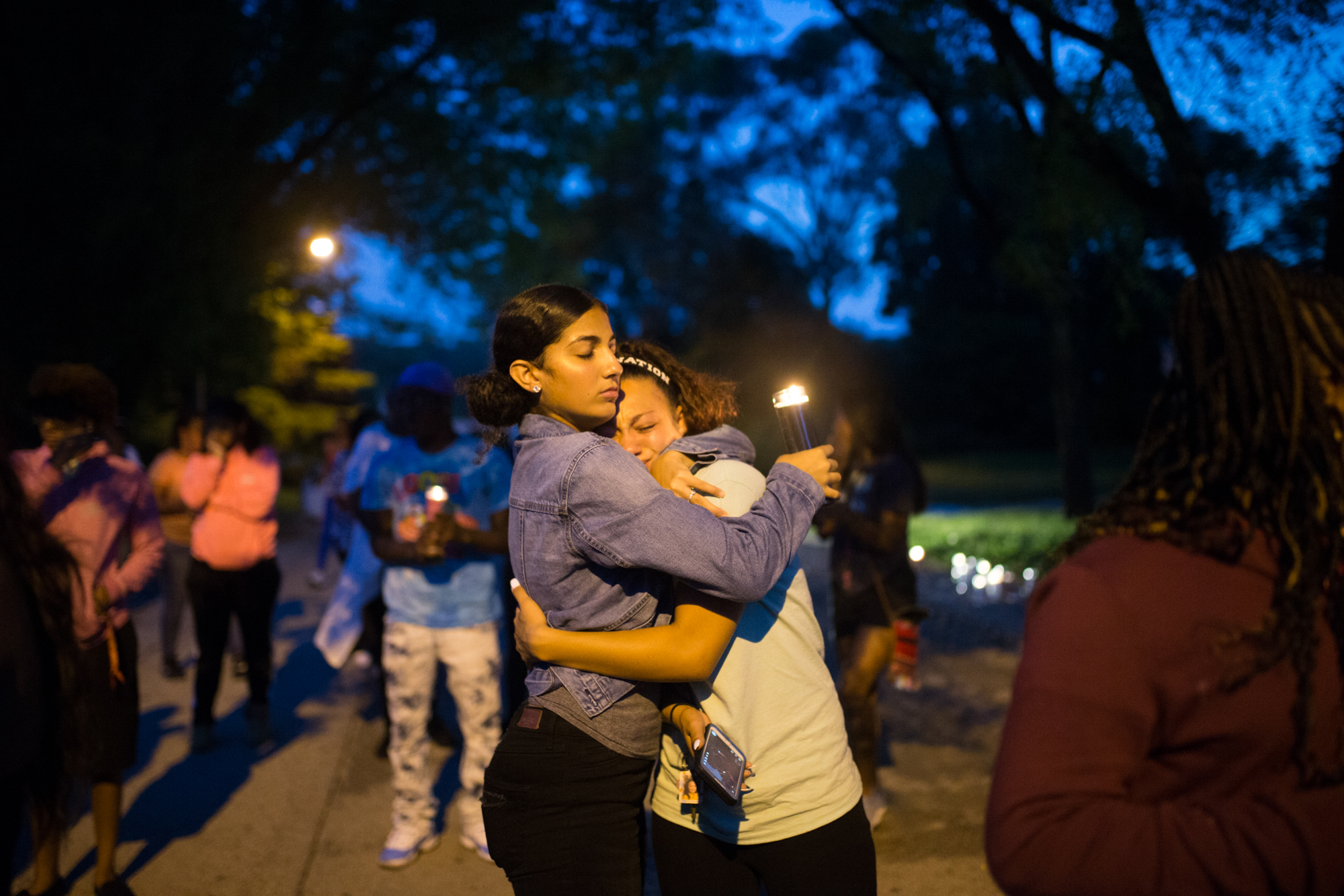 Fatima Alubaidy, 16, left, and Elizabeth Tardio, 17, both classmates of slain Jefferson High School junior Marshawna Williams, tearfully embrace during a candlelight vigil on Thursday, Sept. 20, 2018, in the 2300 block of Clover Avenue where Williams was fatally shot in Rockford. [SCOTT P. YATES/RRSTAR.COM STAFF]