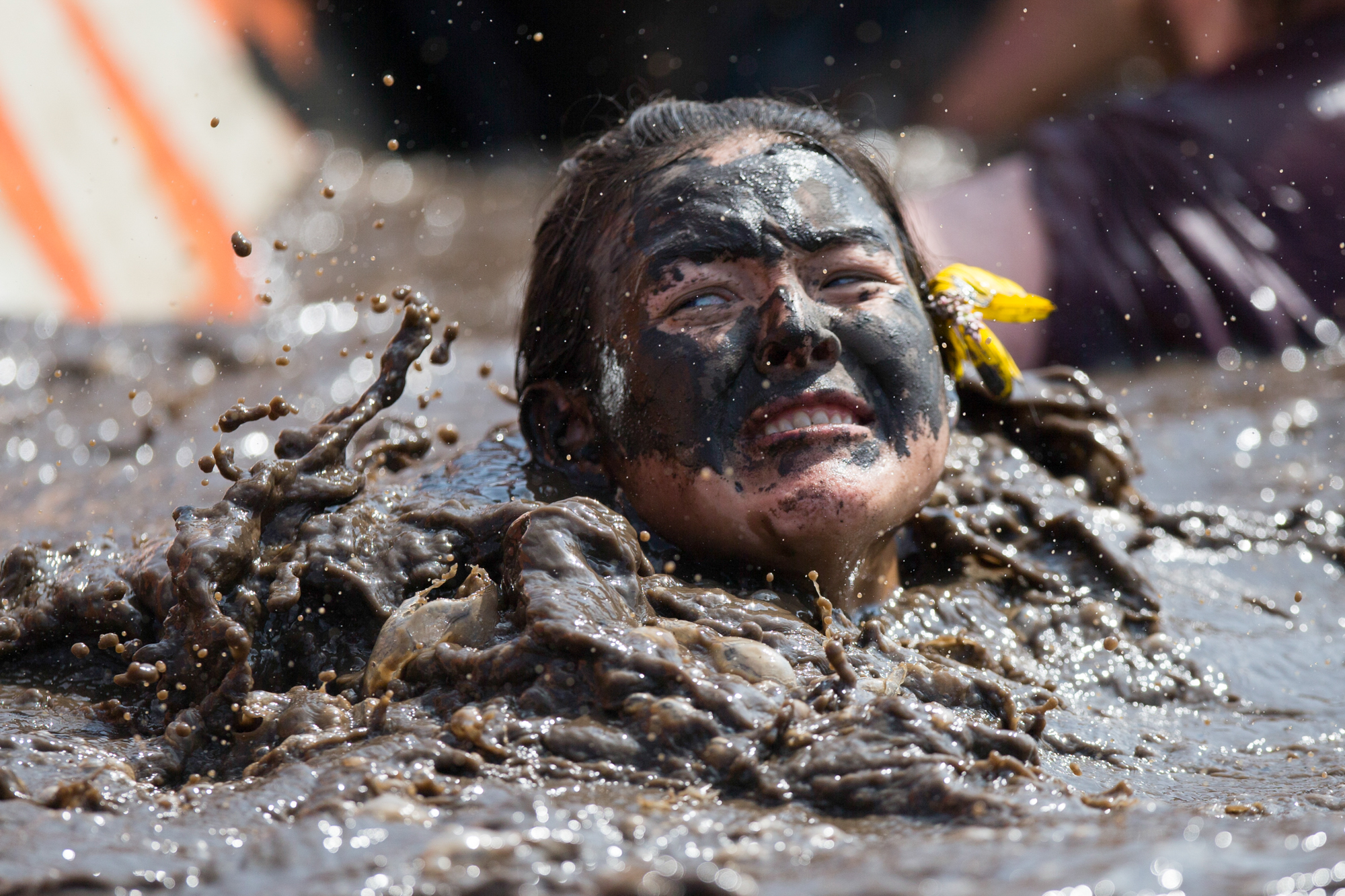 Jessica Le Noue of Luke Air Force Base, Arizona falls into the Block Ness Monster obstacle during the Tough Mudder Chicago obstacle course on Saturday, Aug. 25, 2018, at Chicago Rockford International Airport in Rockford. [SCOTT P. YATES/RRSTAR.COM STAFF]