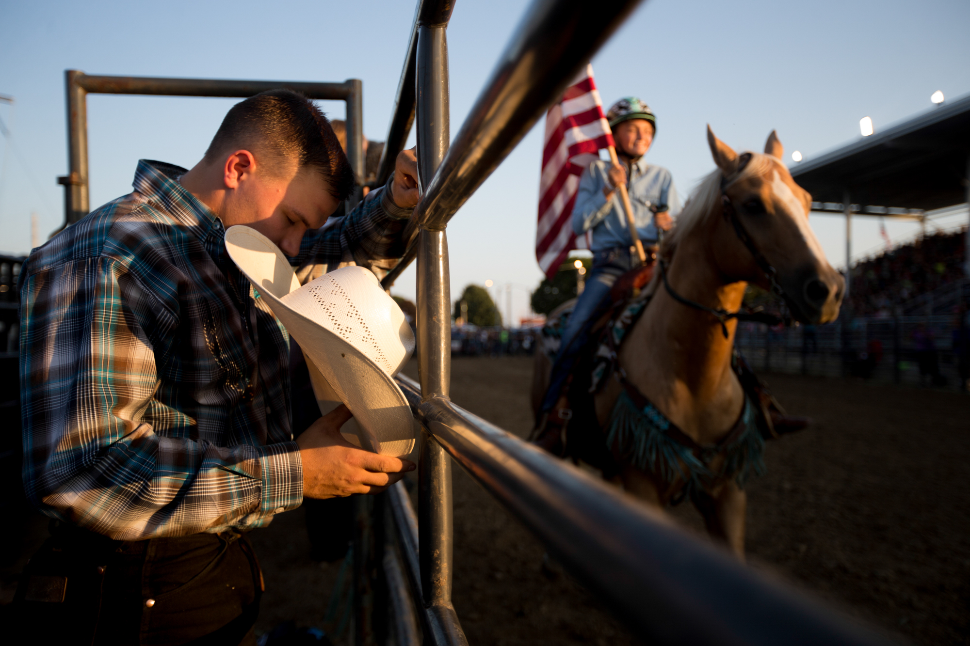 A bull rider prays before the Next Level Pro Bull Riding competition on Friday, Aug. 10, 2018, at Boone County Fairgrounds in Belvidere. [SCOTT P. YATES/RRSTAR.COM STAFF]