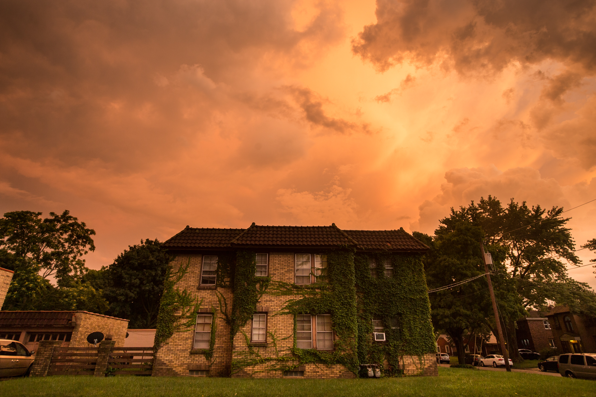The setting sun casts an orange-red hue over Rockford's North End following an evening thunderstorm on Thursday, Aug. 9, 2018. [SCOTT P. YATES/RRSTAR.COM STAFF]