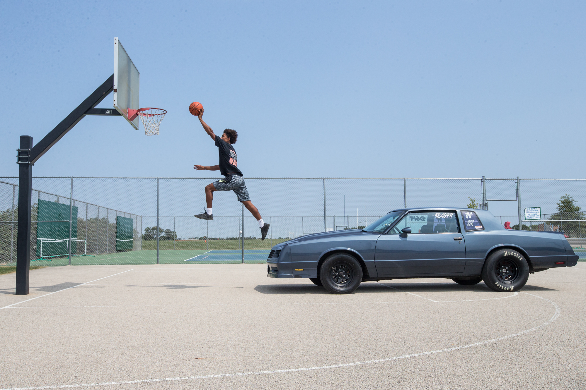 TC Williams, who plays basketball for Winnebago High School and also drag races at the Byron Dragway, poses for a portrait on Friday, Aug. 3, 2018, at a Winnebago Park District basketball court in Winnebago. [SCOTT P. YATES/RRSTAR.COM STAFF]