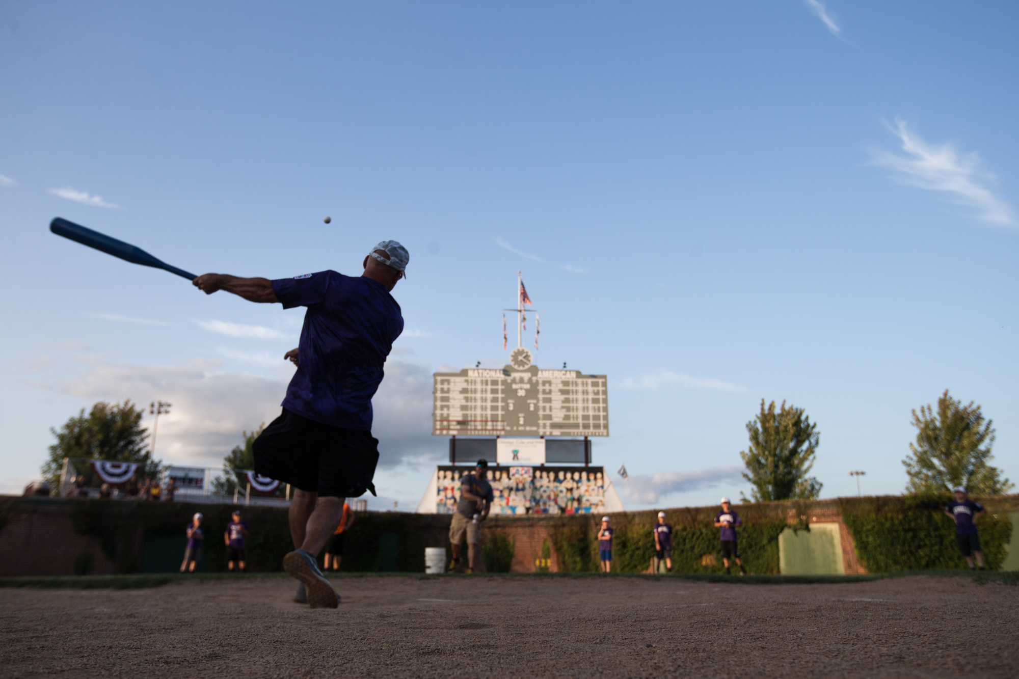 Rochelle coach Jim Gensler watches his hit during the kick-off home run derby event for the Illinois State Little League Championship hosted by Freeport Little League on Friday, July 27, 2018, at Little Cubs Field in Freeport. [SCOTT P. YATES/RRSTAR.COM & THE JOURNAL-STANDARD STAFF]