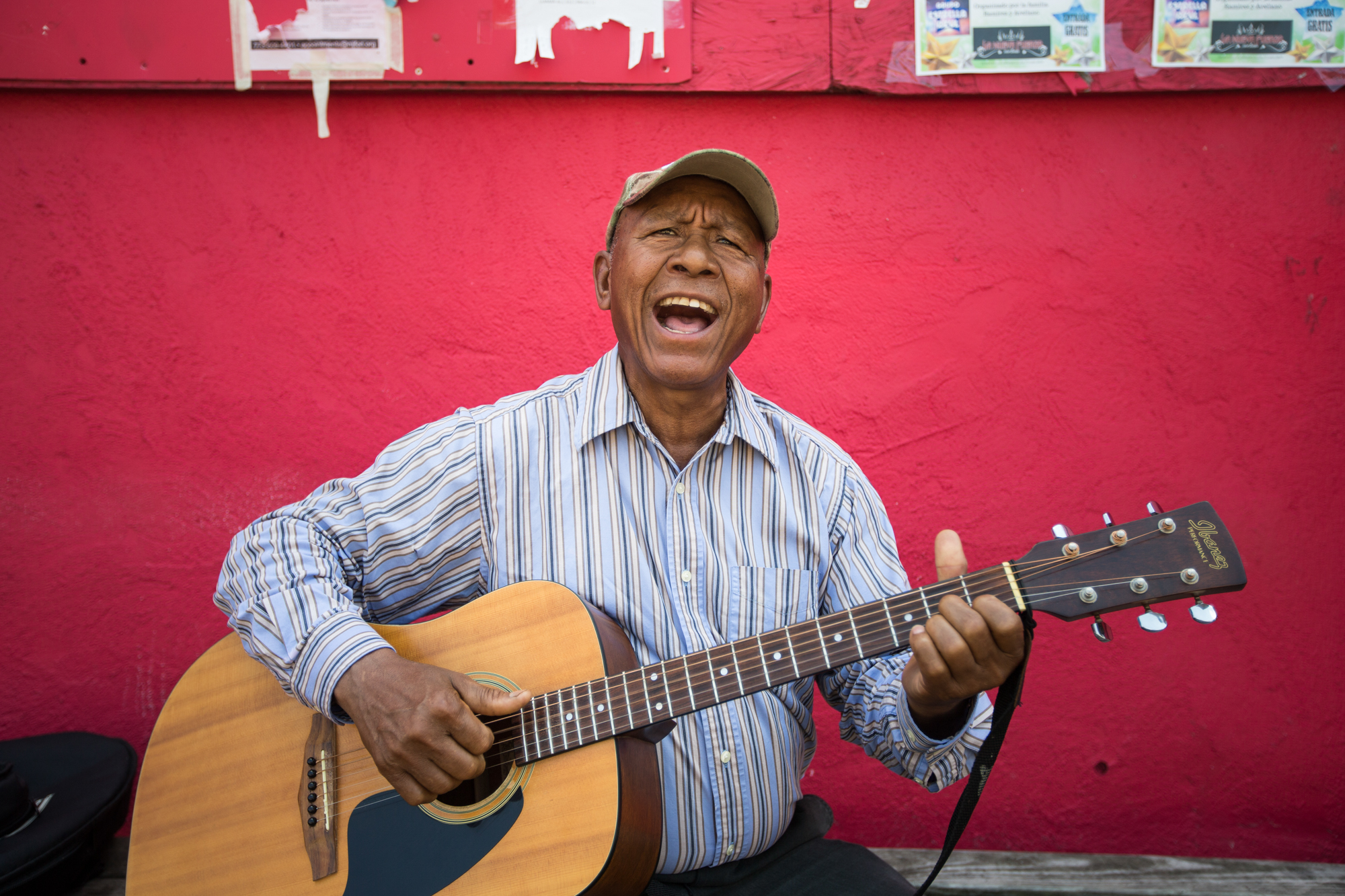 Martin C. Quiterio of Rockford sings a Mexican song and eats a frozen drink outside a shop on Friday, July 13, 2018. The National Weather Service issued a hazardous weather outlook Friday for portions of North Central