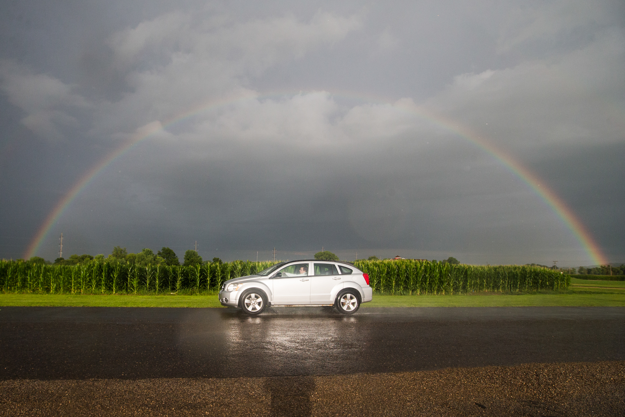 A rainbow arcs over a cornfield during thunderstorms on Thursday, July 19, 2018, near Lena Brewing Company in Lena. [SCOTT P. YATES/RRSTAR.COM & THE JOURNAL-STANDARD STAFF]