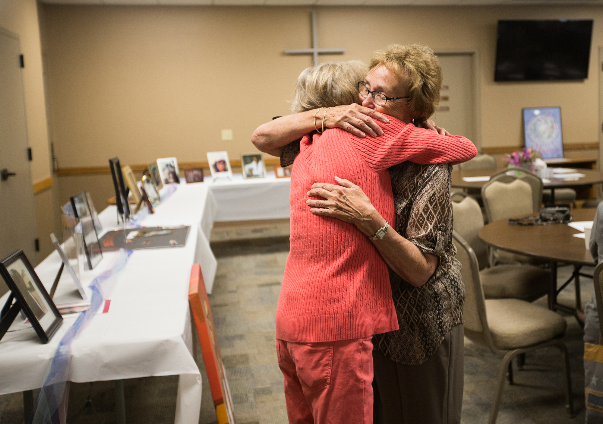 Cathy Schocker of Rockford, left, and retired Winnebago County Coroner Sue Fiduccia hug before the 13th annual Carol McFeggan Homicide Victim Memorial Service on Wednesday, June 20, 2018, at Riverside Community Church in Machesney Park. [SCOTT P. YATES/RRSTAR.COM STAFF]
