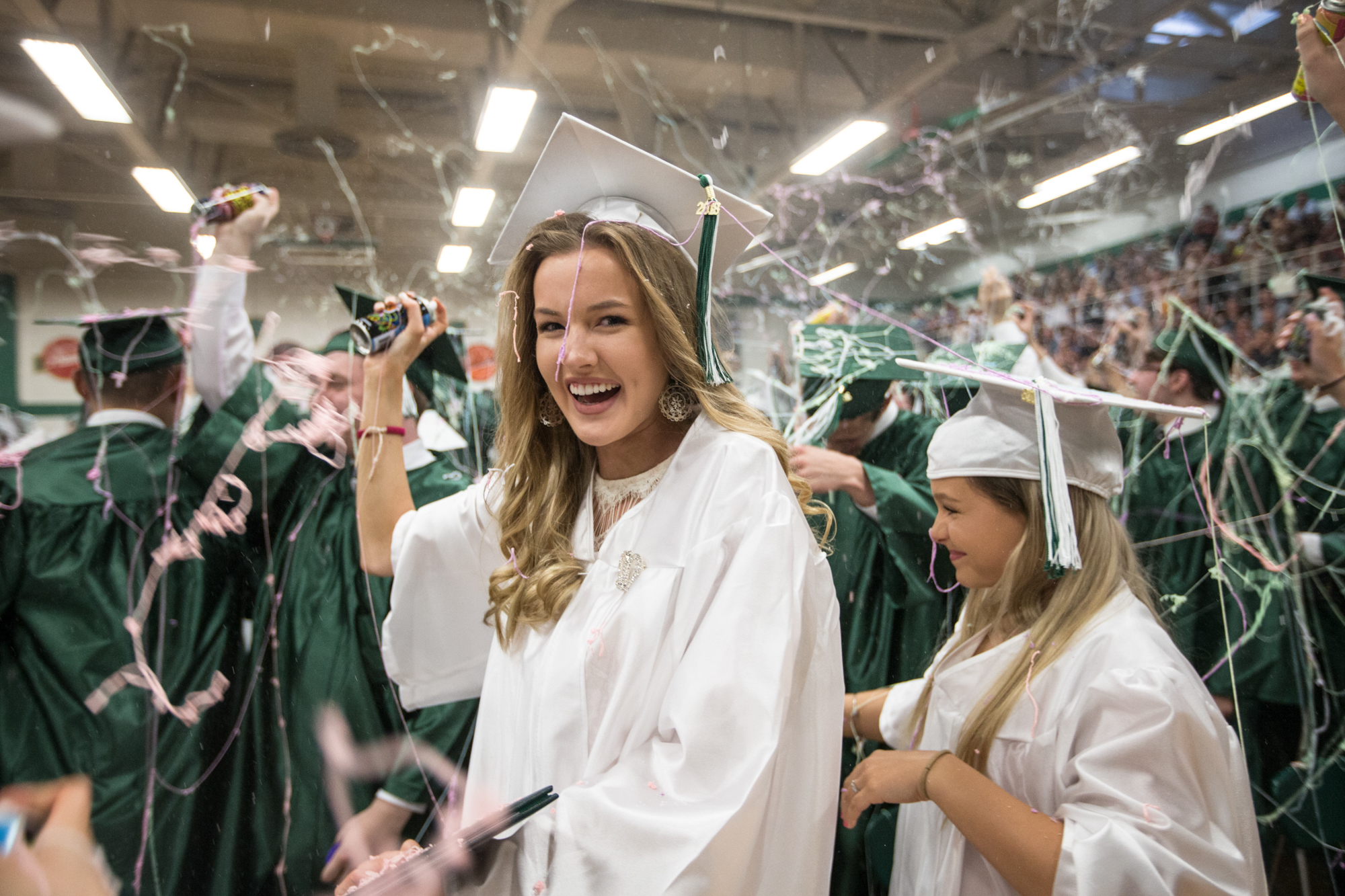 Lauren Clemens reacts after graduates sprayed Goofy String in the air as Boylan Catholic High School celebrates its commencement on Friday, May 25, 2018, at Boylan Catholic High School in Rockford.