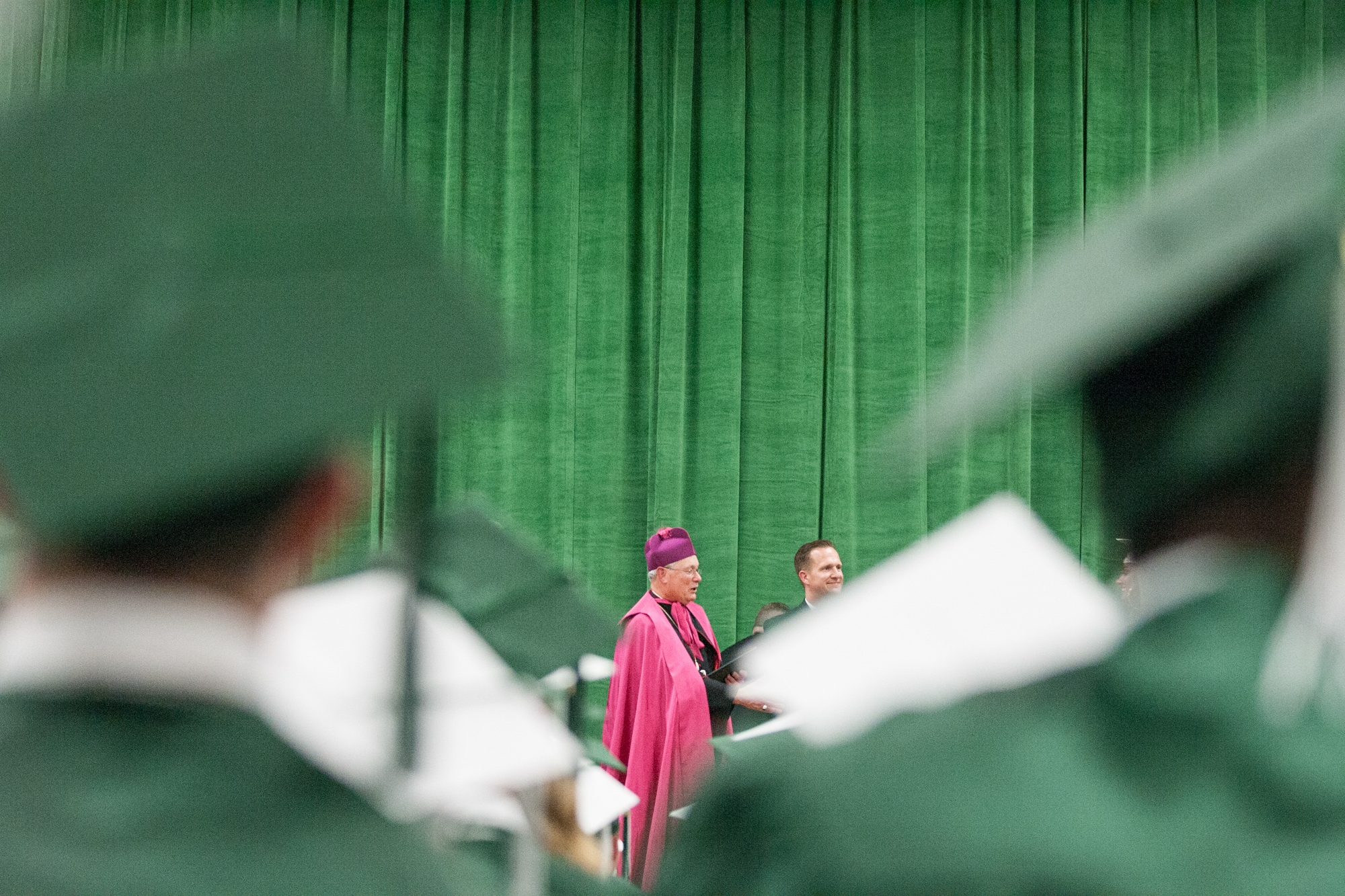 Rev. David Malloy, center, confers diplomas to graduates during commencement on Friday, May 25, 2018, at Boylan Catholic High School in Rockford. [SCOTT P. YATES/RRSTAR.COM STAFF]