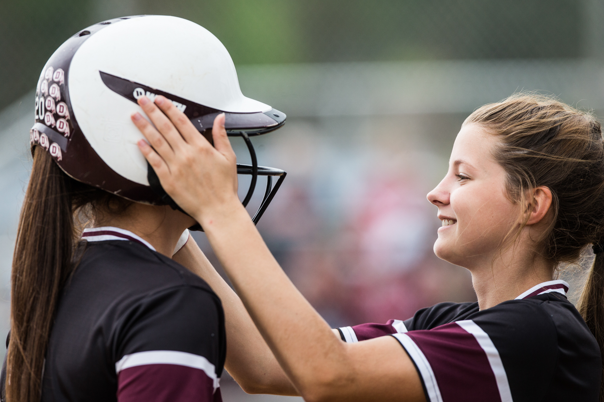 Dakota's Toni Stubbe, right, gives a pep talk to batter-on-deck Grace Sutherland during their 1A regional final game against Forreston on Saturday, May 19, 2018, at Read Park in Freeport. Dakota beat Forreston, 11-10.