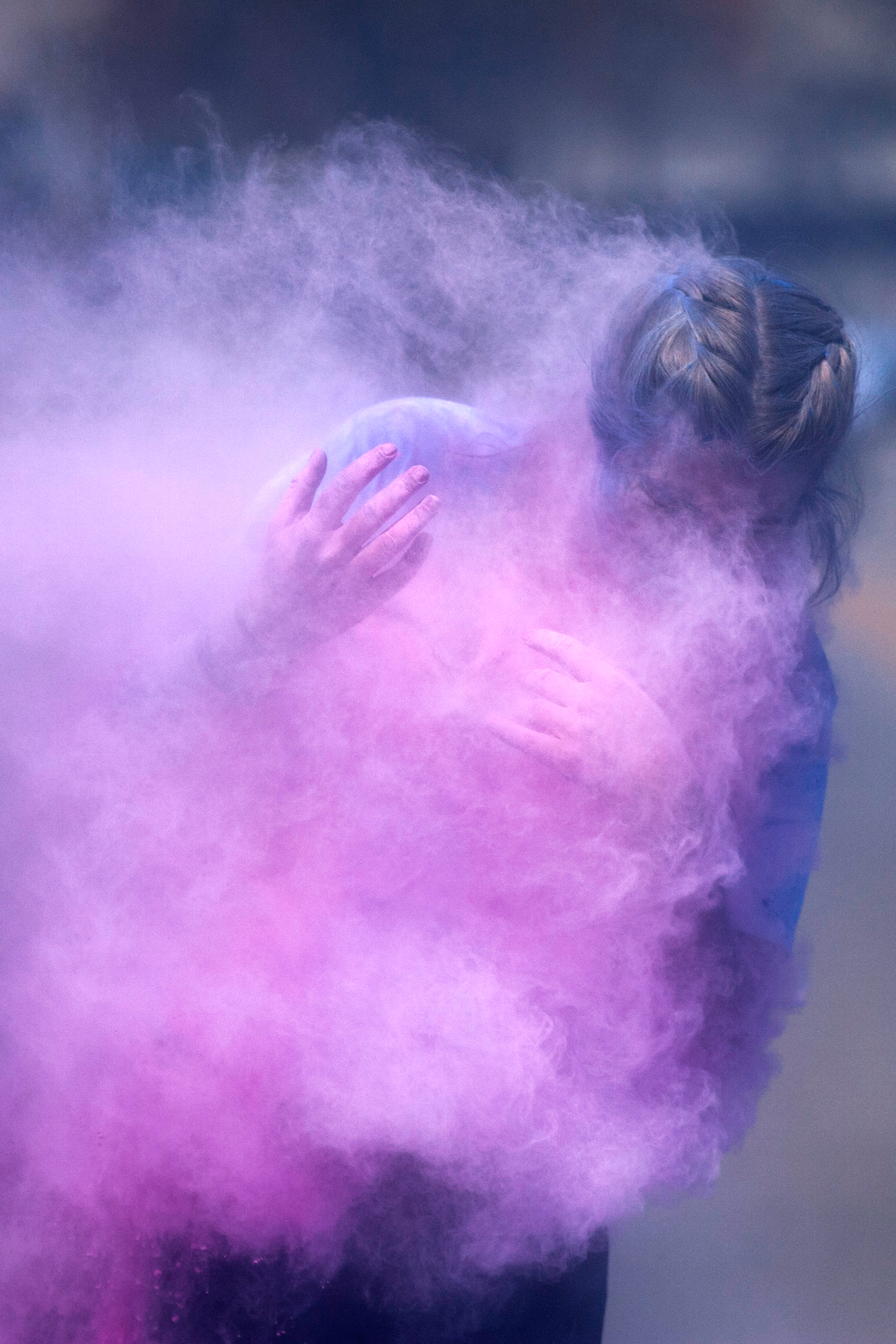 Linnea Sayler, a staffer from the Rockford YMCA, is covered in a cloud of colored chalk by a co-worker while staffing the half-mile Color Fun Run component of the YMCA Heritage Run event on Saturday, April 28, 2018, on the East State Street bridge in Rockford. [SCOTT P. YATES/RRSTAR.COM STAFF]