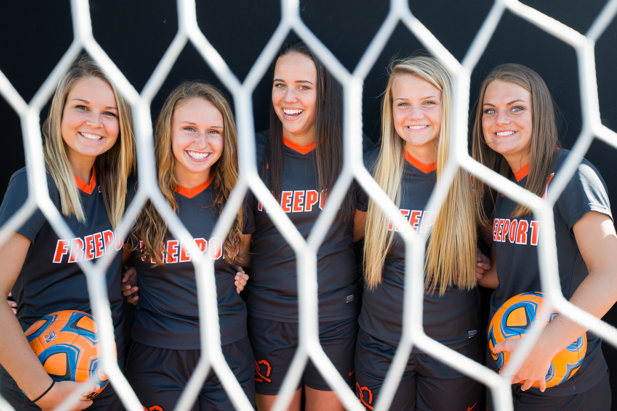 Freeport girls soccer seniors, from left, Montanna Stewart, Josie McDermott, Cassidy Grunewald, Ally Hasken, Sam Brooks,  and , who have all played varsity since they were freshmen, pose for a portrait on Wednesday, April 25, 2018, at the Freeport High School athletic field in Freeport. [SCOTT P. YATES/THE JOURNAL-STANDARD STAFF]