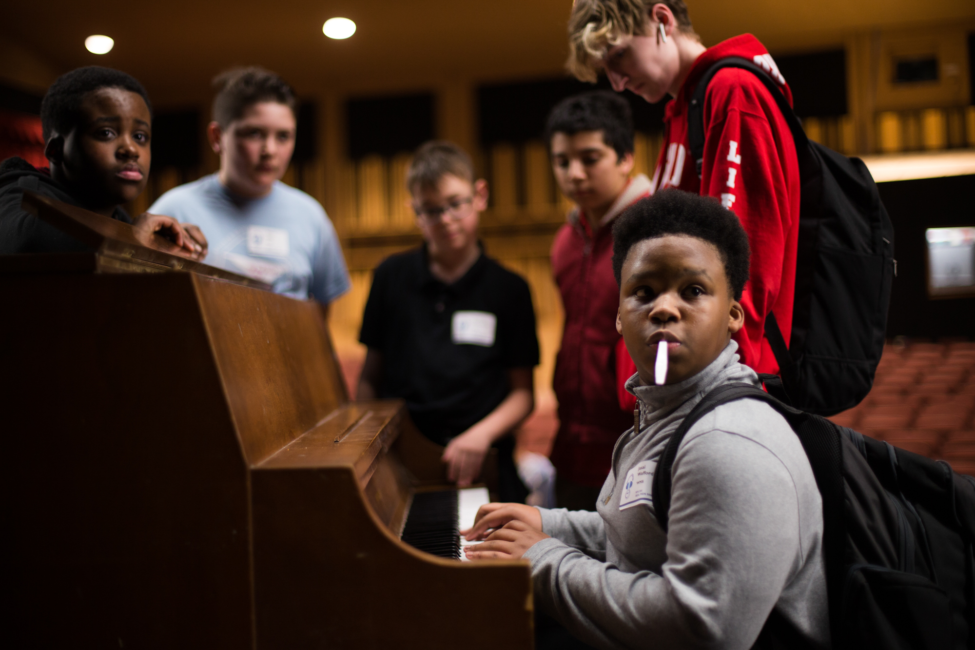 West Middle School student Jasai Wafford, right, plays piano as other students watch after a Real Men Sing, a workshop celebrating young men who sing with Rockford school choirs, on Friday, April 13, 2018, at Auburn High School in Rockford. [SCOTT P. YATES/RRSTAR.COM STAFF]