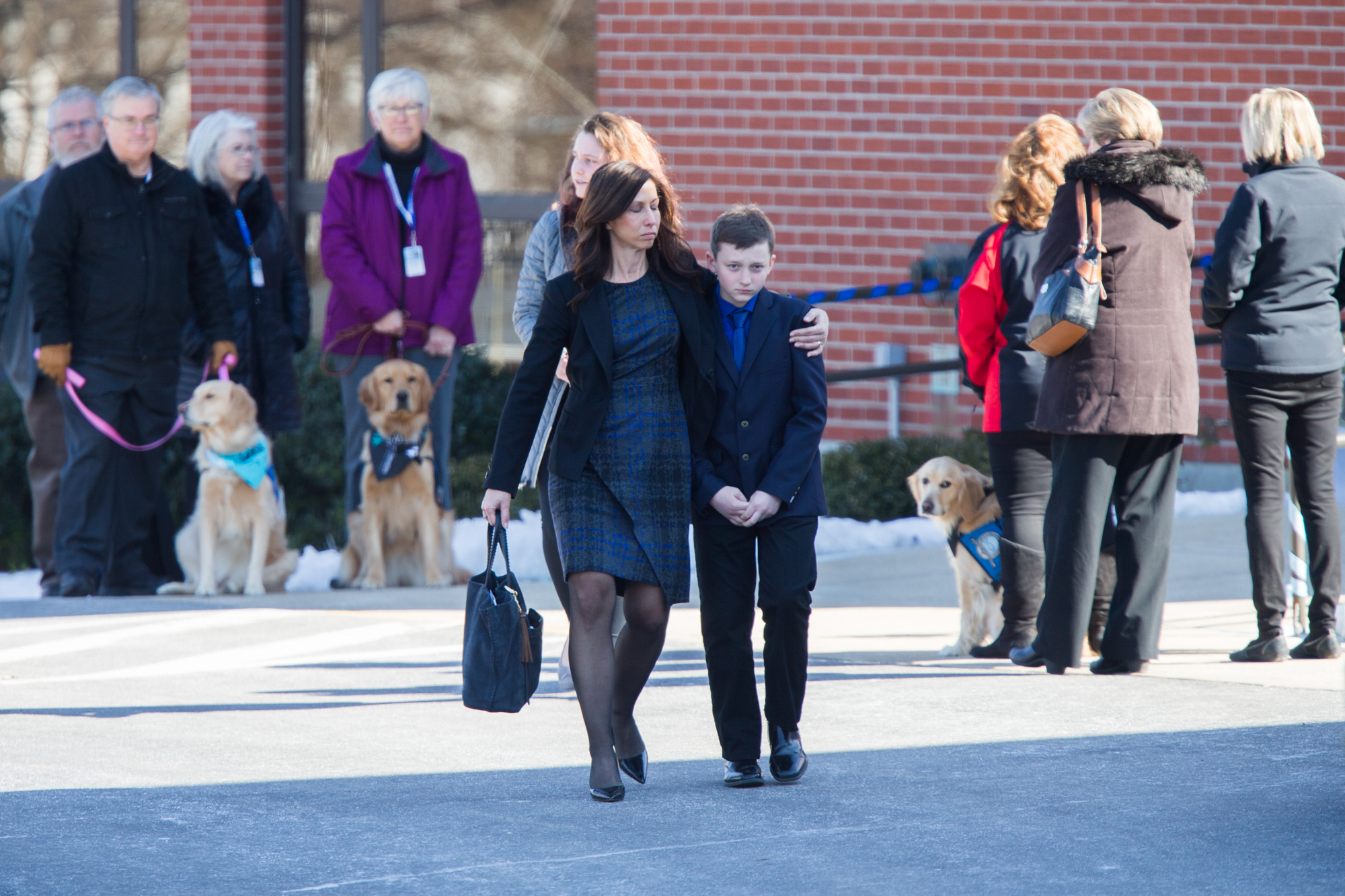 Family, friends and community members leave at the end of the funeral for Christopher Ruckman, 14, and his brother John Ruckman, 12, on Friday, March 9, 2018, at Our Savior's Lutheran Church in Rockford. [SCOTT P. YATES/RRSTAR.COM STAFF]