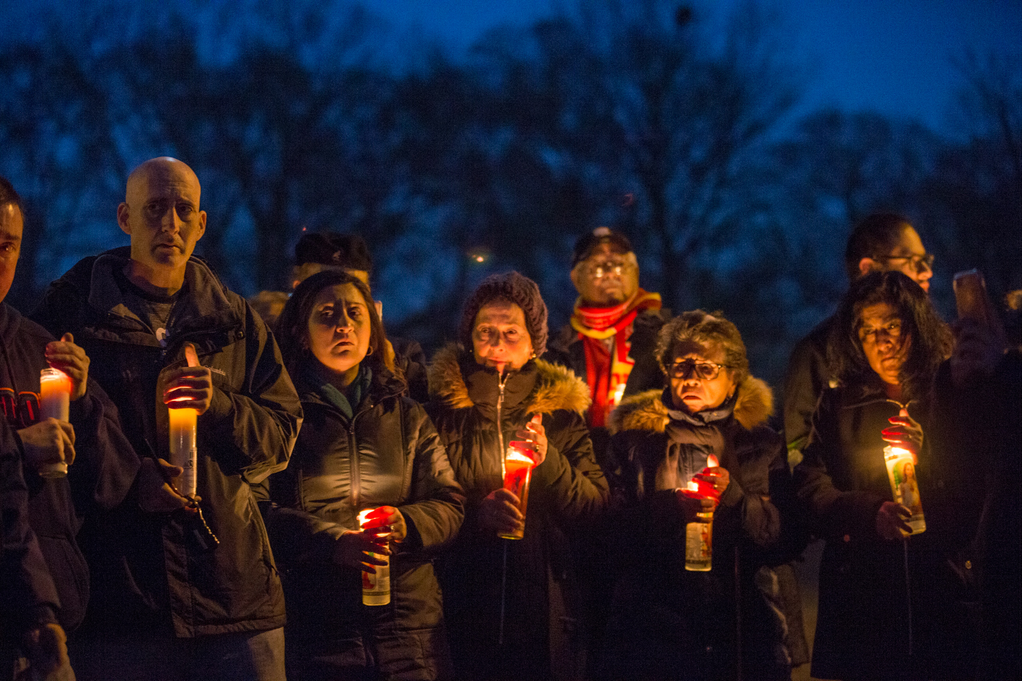 Family, friends, co-workers and community members gather at a candlelight vigil in memory of Danielle Son and Sergio Quiroz on Tuesday, Feb. 27, 2018, at 10th Avenue Park in Rockford. [SCOTT P. YATES/RRSTAR.COM STAFF]