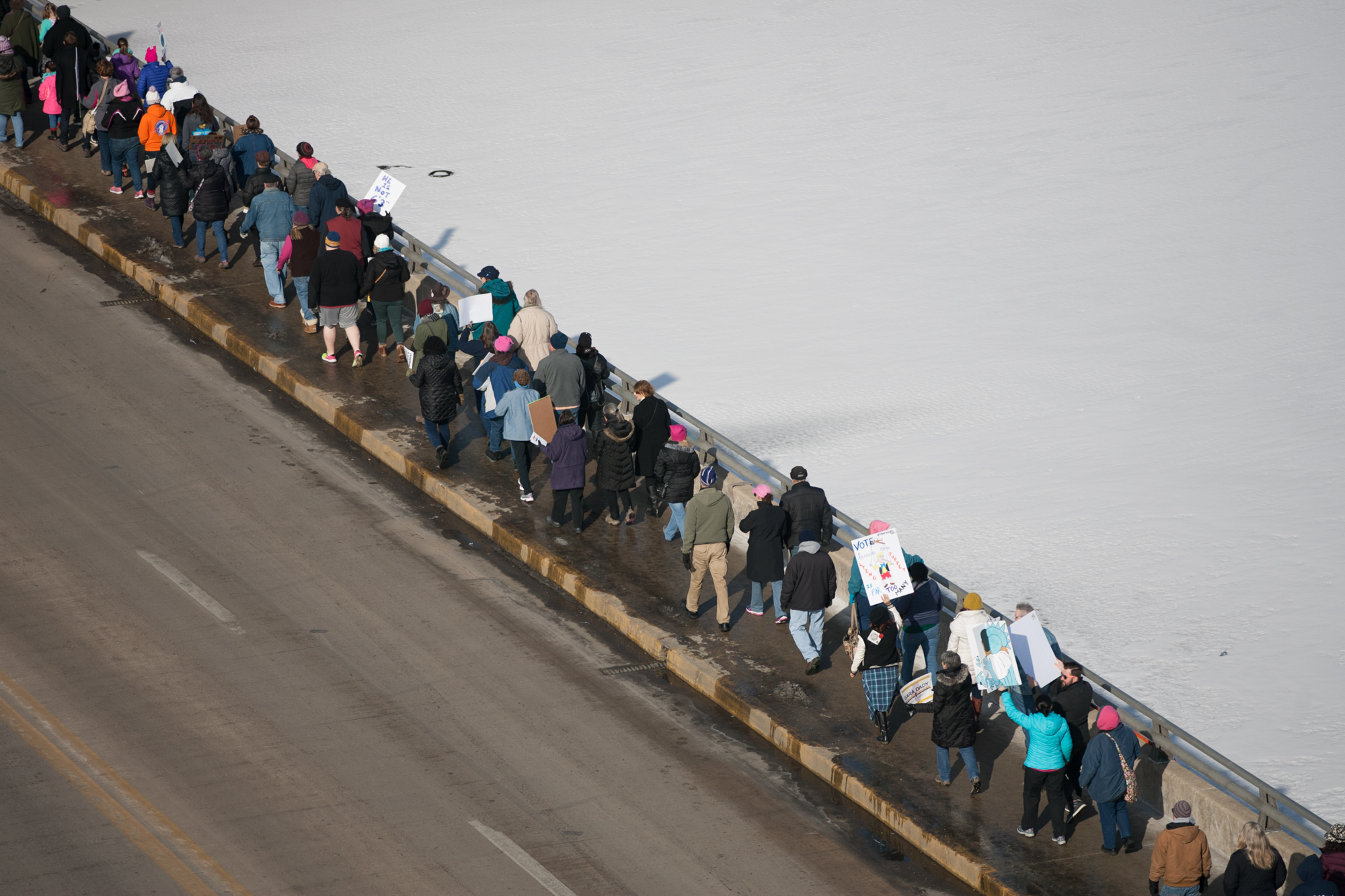 Participants of the second Rockford Women's March walk to protect and advance women's rights on Saturday, Jan. 20, 2018, at State Street in Rockford. [SCOTT P. YATES/RRSTAR.COM STAFF]