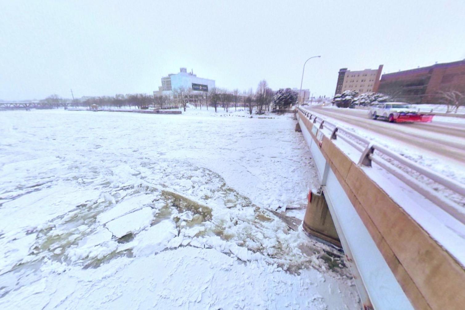 The Rock River freezes under the Chestnut Street bridge on Friday, Jan. 25, 2019, in Rockford. [SCOTT P. YATES/   RRSTAR.COM    STAFF]
