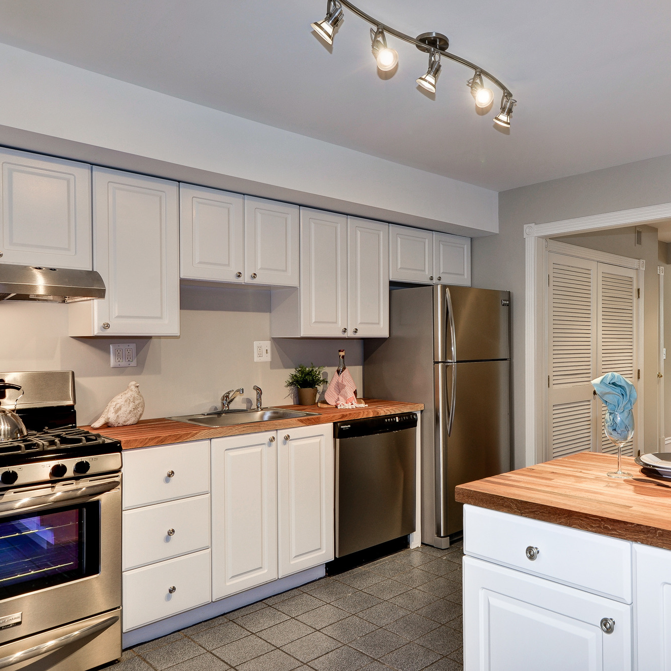 After : keeping the cabinets, updating the counters and appliances brought back warmth to this home's heart