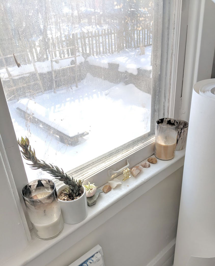I had a bunch of canvases stacked over the window, which is fine in the winter but that space out there will be my little herb garden and I know in the spring/summer I'm going to appreciate seeing the plants grow as I paint.