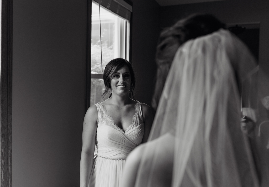 Brides first look with sister.