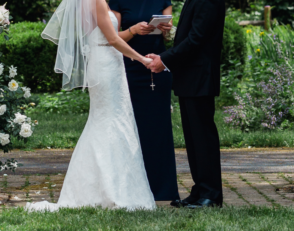 Park of Roses wedding, Columbus OH. Bride and groom holding hands.