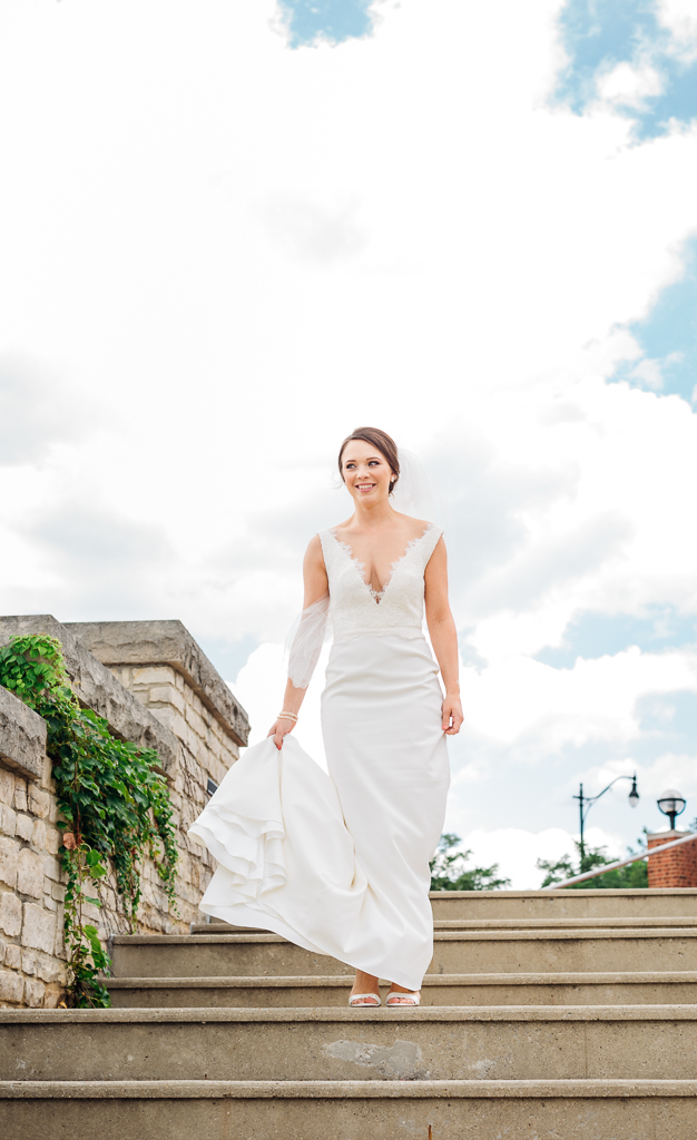 This bride looks like a princess as she walks down the stairs for a first look with her groom before their wedding at Northbank Park and pavilion in Columbus OH.