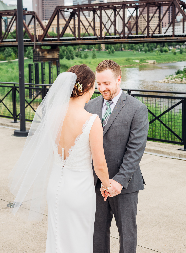 Groom holds back tears when seeing his bride for the first time in her wedding dress before their wedding ceremony at Northbank Park in Columbus OH