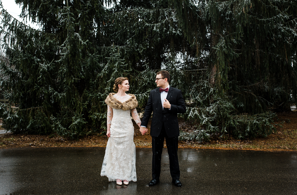 snowing-on-bride-groom-winter-wedding-homestead-park-watersedge-columbus-ohio-wedding-photographer4.jpg