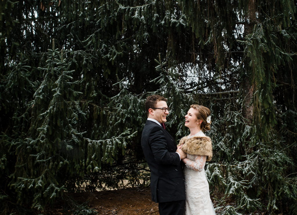 snowing-on-bride-groom-winter-wedding-homestead-park-watersedge-columbus-ohio-wedding-photographer3.jpg