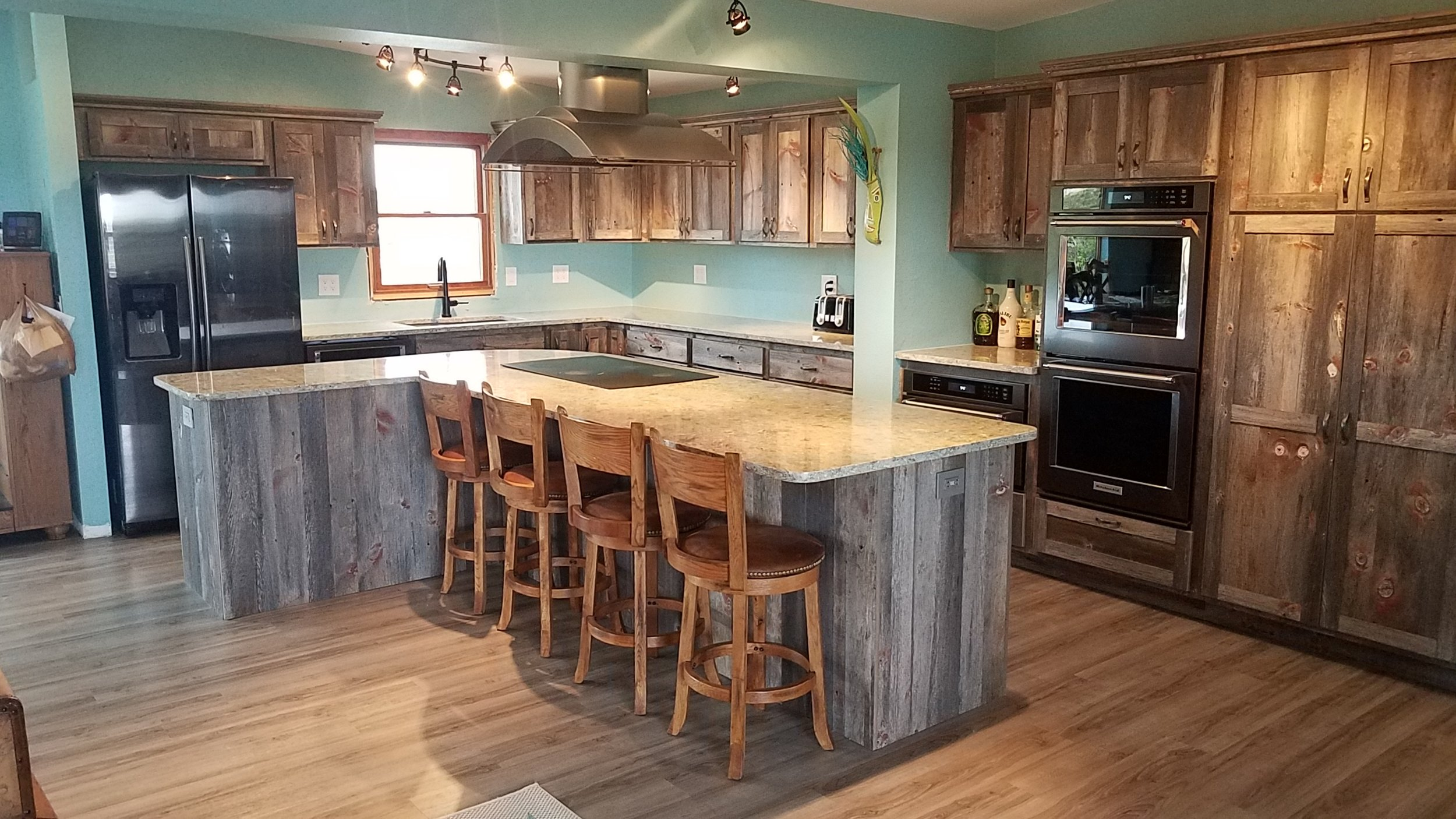 Weathered Gray Reclaimed Barnwood Kitchen designed and built by Vienna Woodworks LLC. The comapny ships full kitchens nationwide and to Canada.