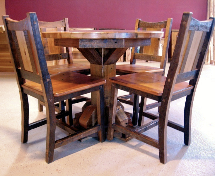 Brown reclaimed barn wood table and chairs made from authentic barn wood. No stain was used on these furniture pieces since the rich patina that develops on the wood over a hundred years is what makes this product unique from manufactured furniture.