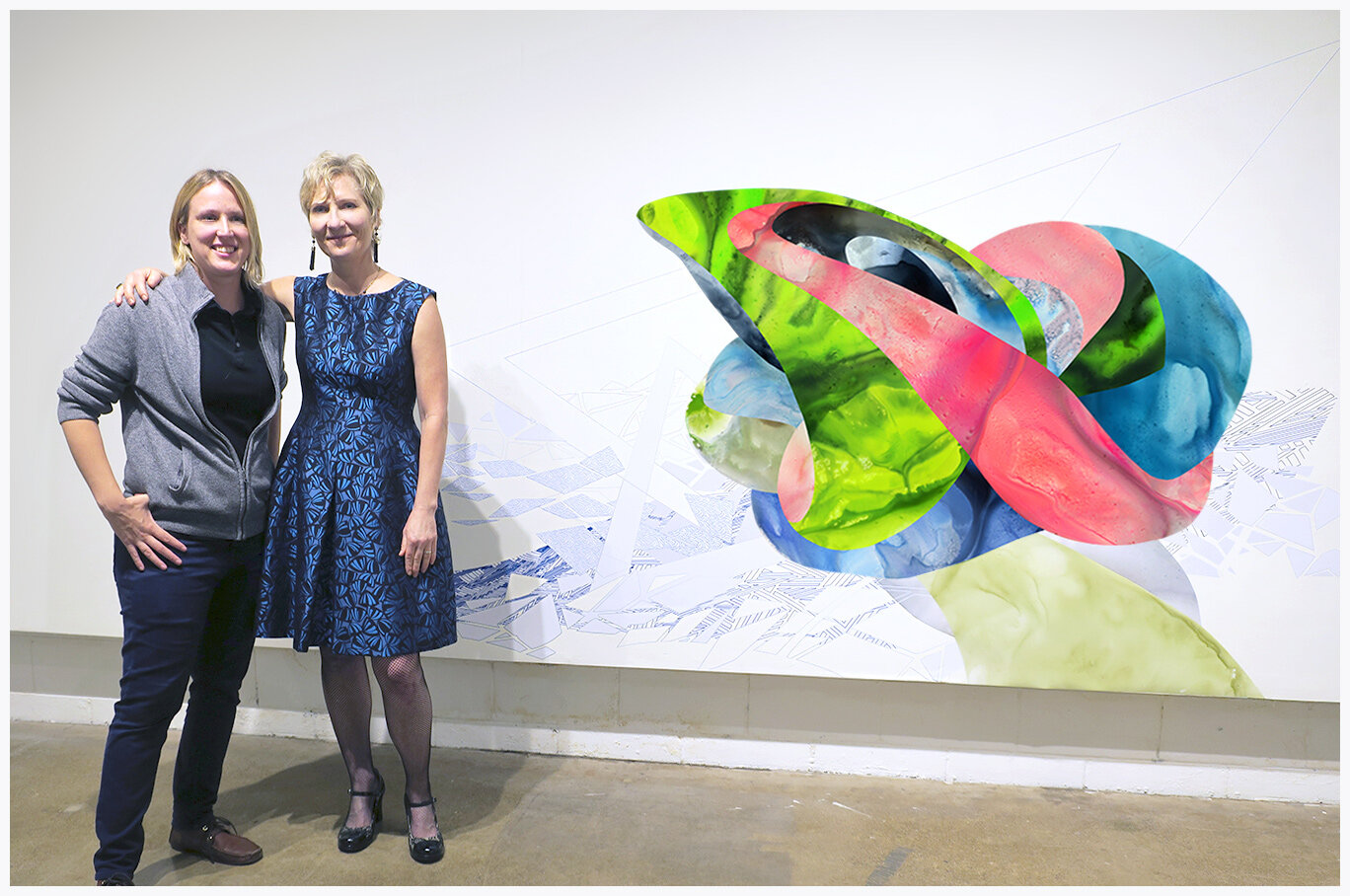 Melissa Breitenfeldt and me at the Rosalux Gallery Opening by our vinyl wall piece collaboration .