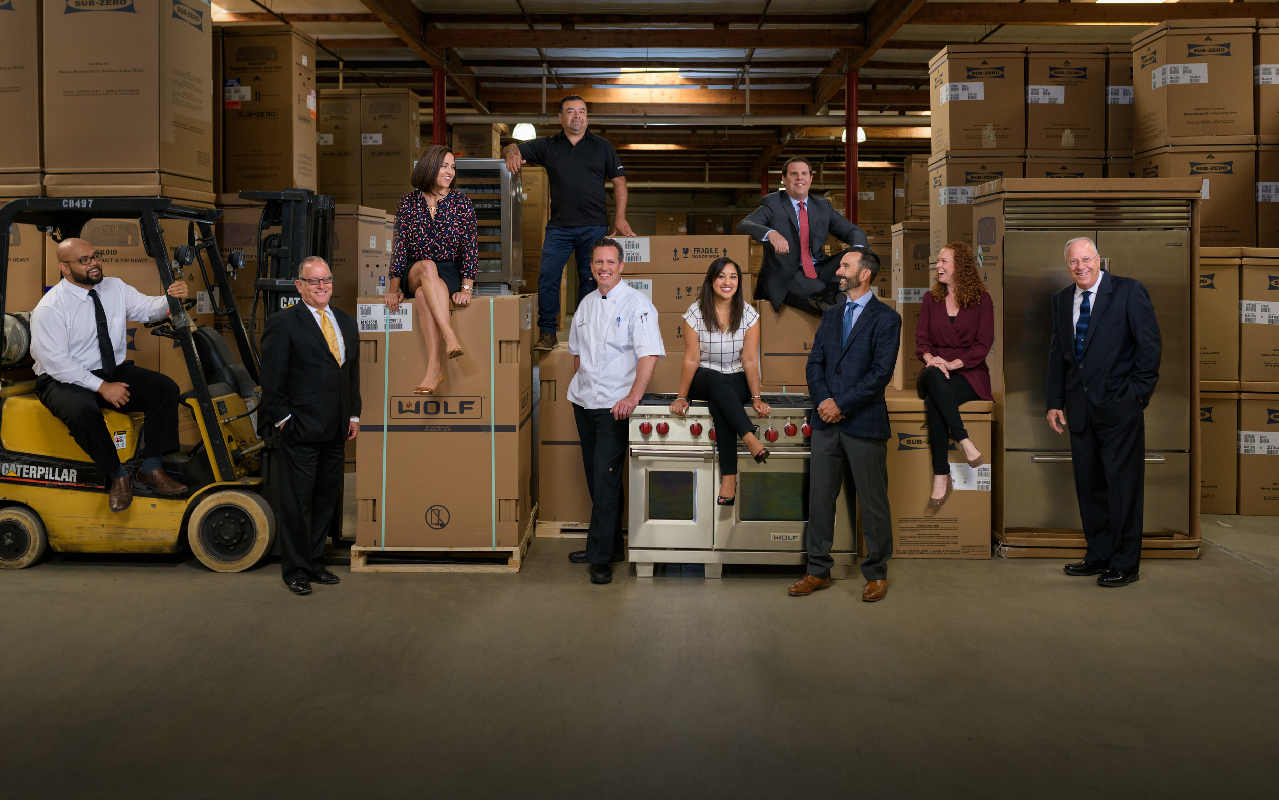 Final photoshop composite image of 10 business executives after hundreds of individually lit photos.