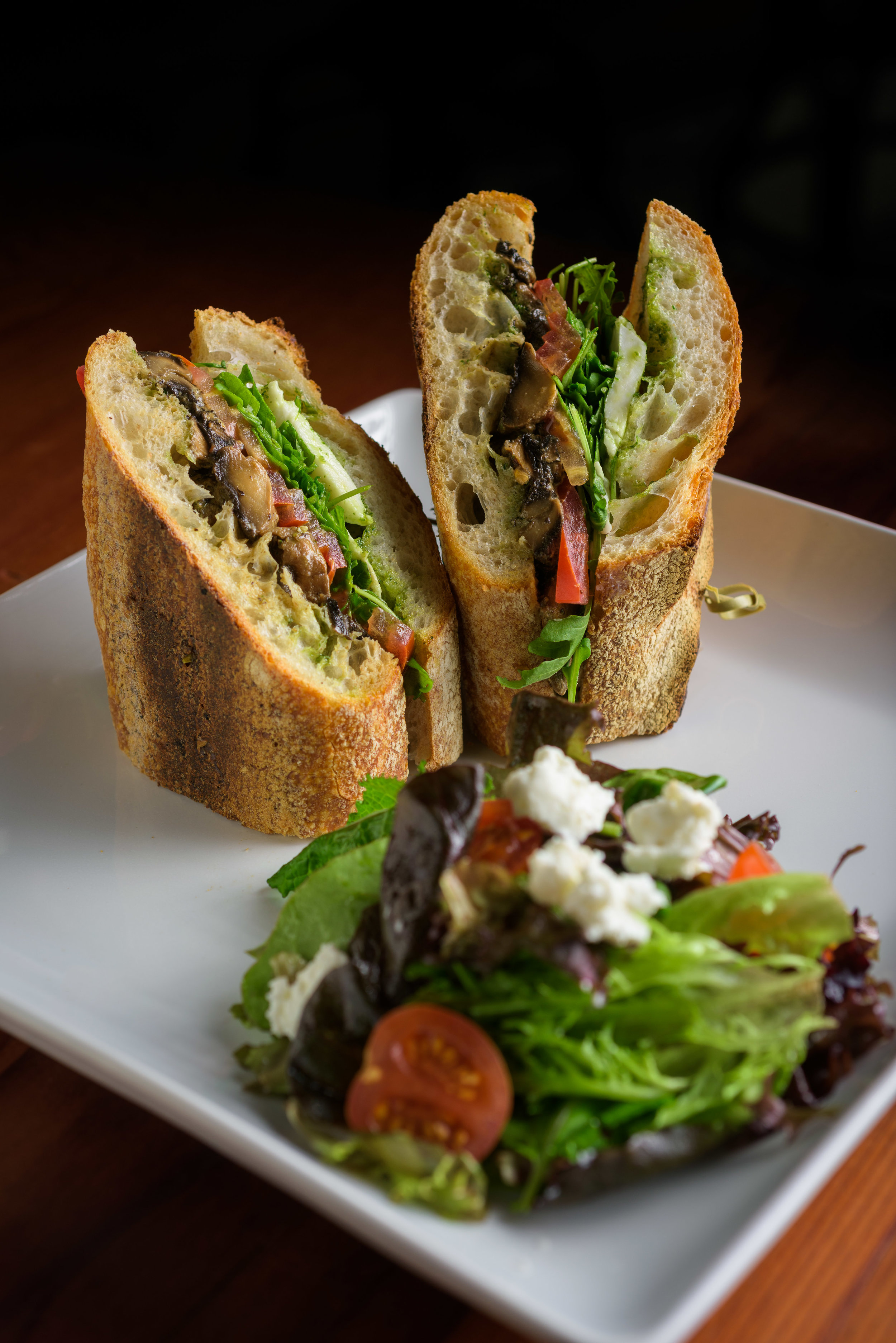 two half sandwiches on a plate with salad - Cupertino food photography - RootStock Wine Bar - photos by Bay Area commercial photographer Chris Schmauch