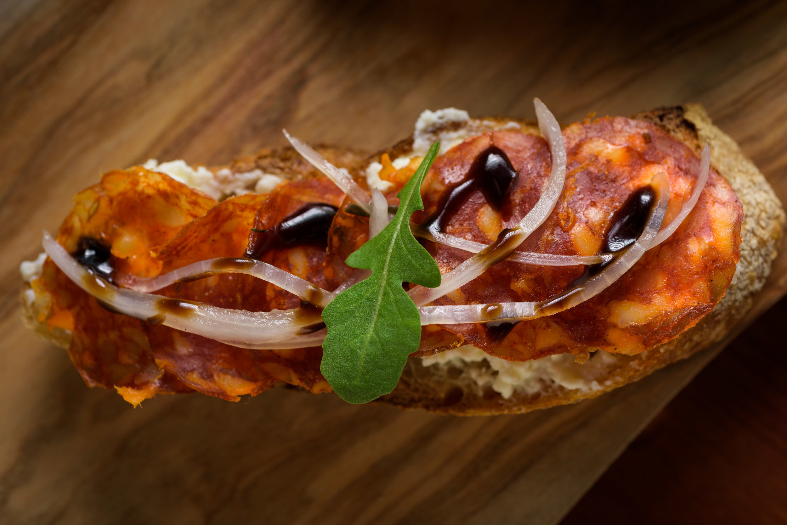 flatbread with sliced meats - Cupertino food photography - RootStock Wine Bar - photos by Bay Area commercial photographer Chris Schmauch