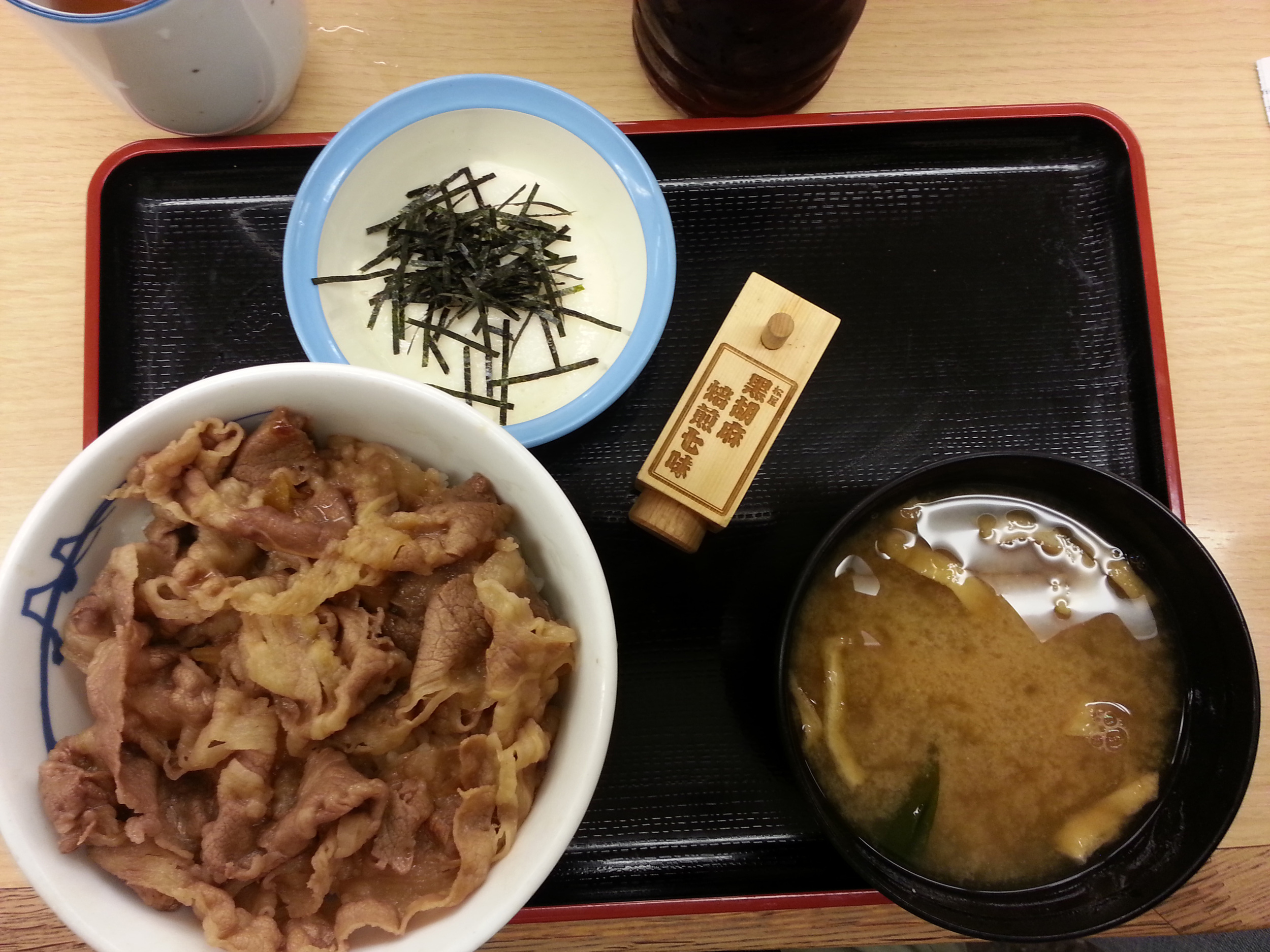Our first meal in Japan. Beef bowl with rice, miso soup and grated yams. Price: $5