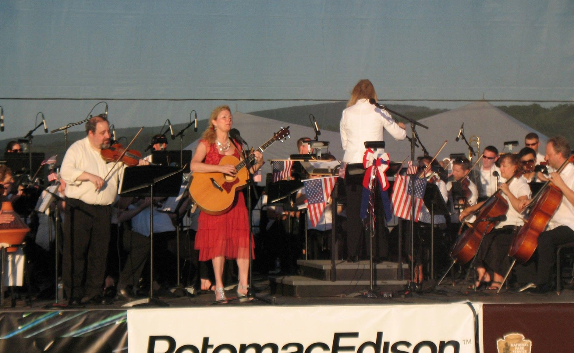 With Jennie Avila and the Maryland Symphony Orchestra under the direction of Elizabeth Schulze. This was for the orchestra's July 4th concert at the Antietam Battlefield. I got to play 2 of Jennie's songs with her and the orchestra and they played an orchestration I did. July 2013