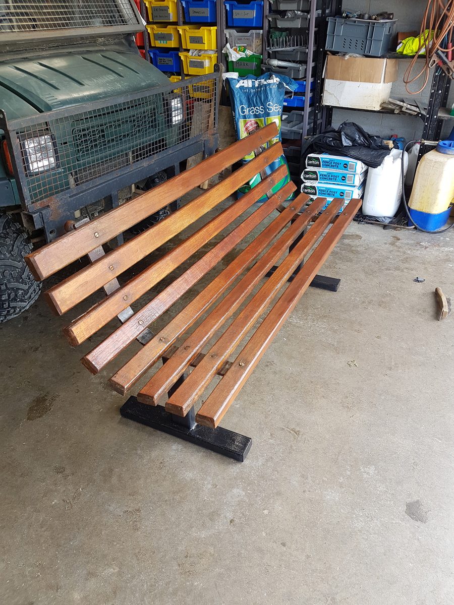 Mike Smith painting bench and car park posts