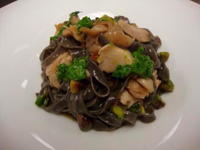 Black olive Tagliatelle, braised rabbit, ramp pesto, pistachio