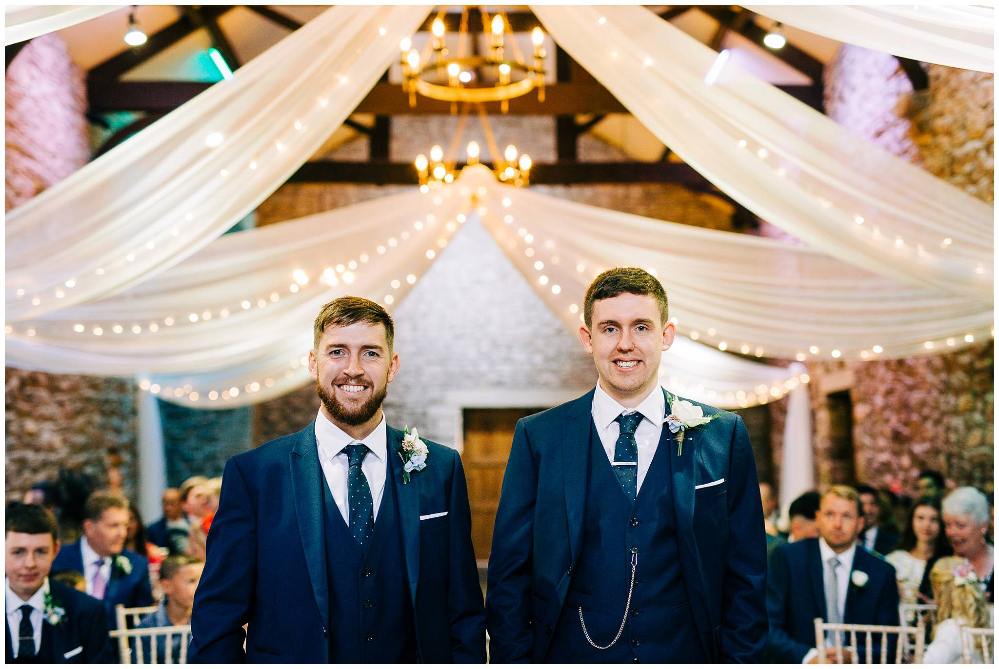 the groom and his best man smile for a portrait before the brides arrival