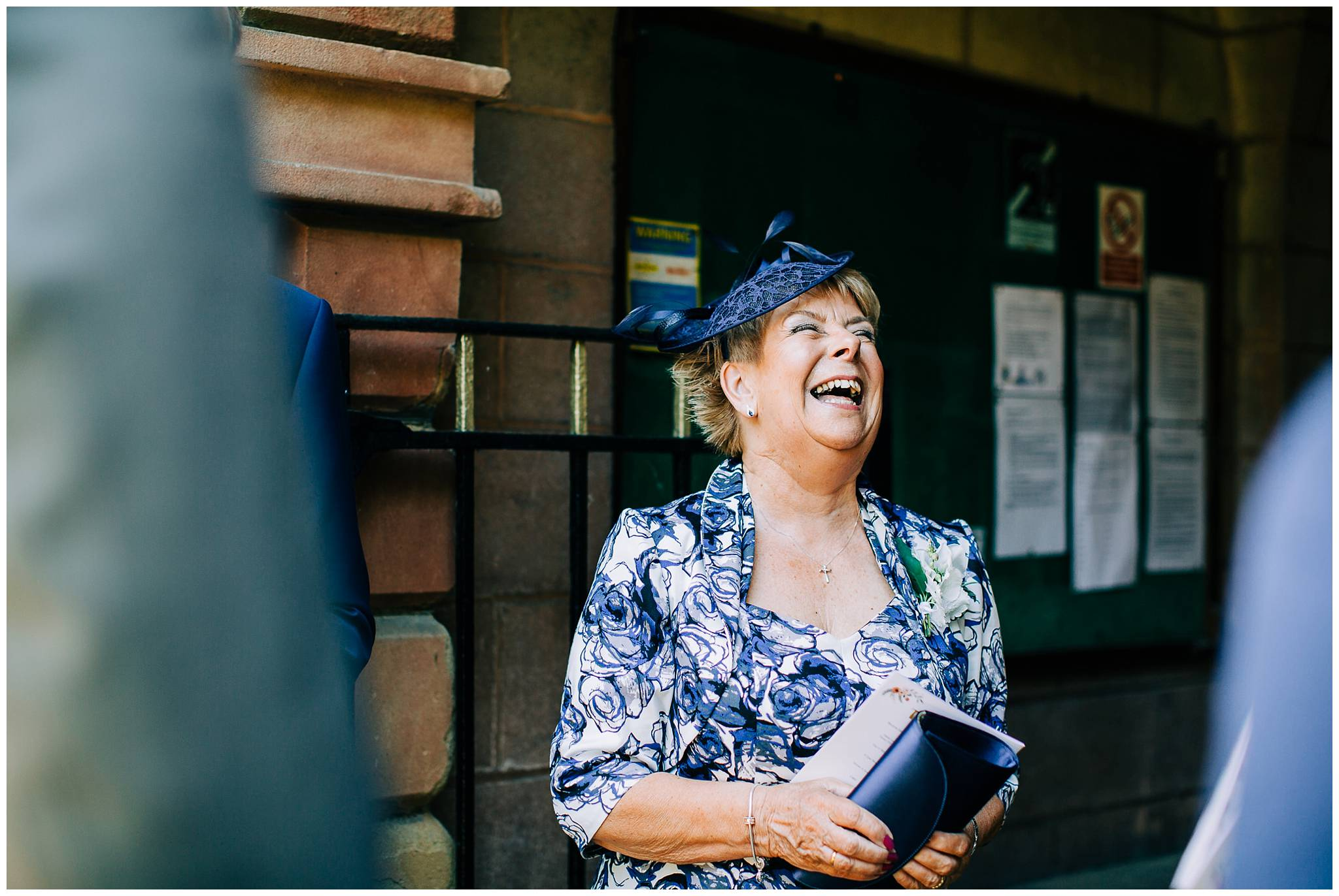 mother of the groom laughing whilst talking to others