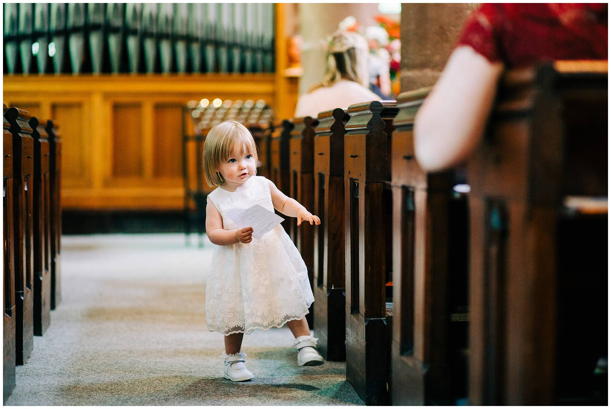 little girl walking at the end of the aisle