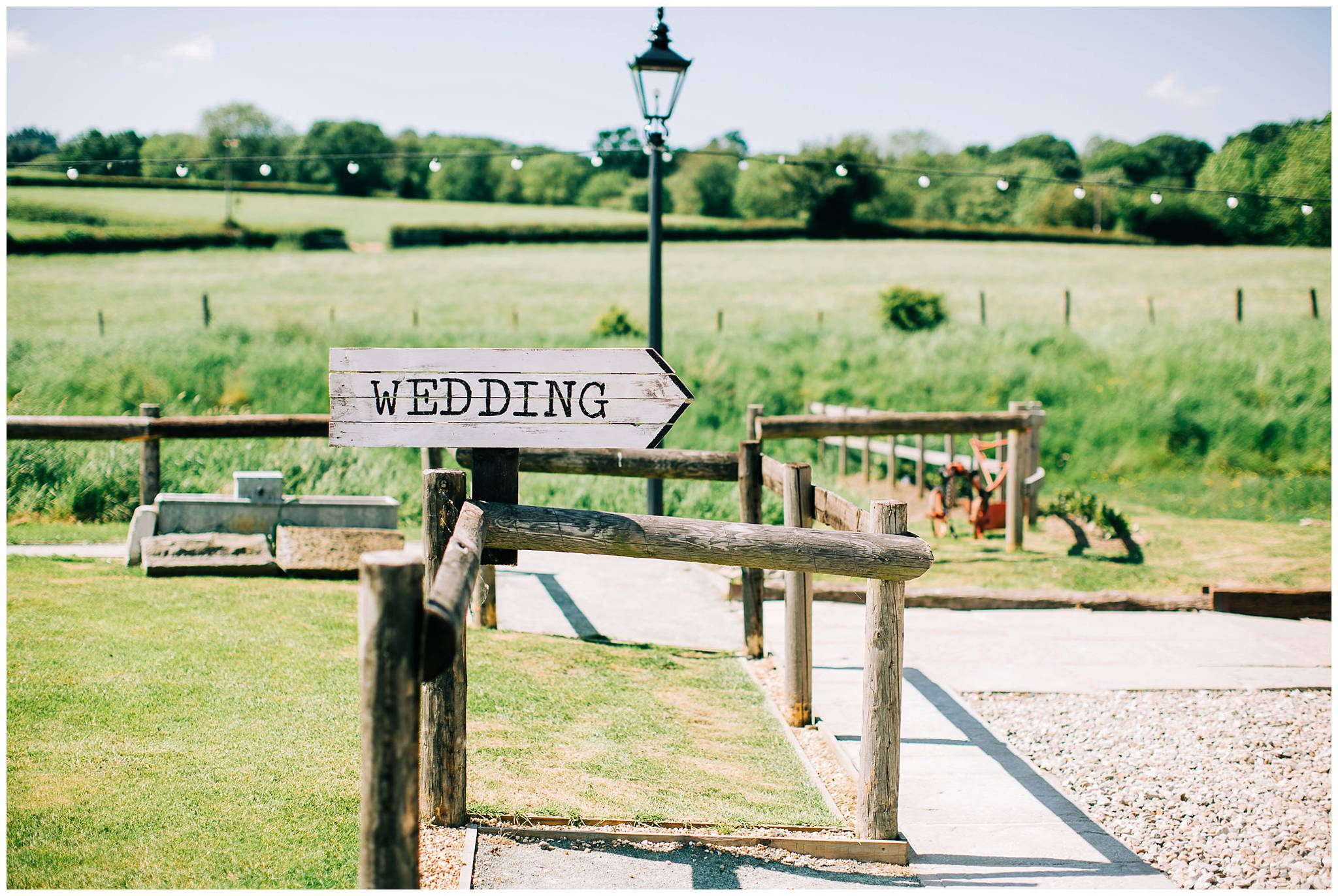 a rustic wedding sign in the shape of an arrow