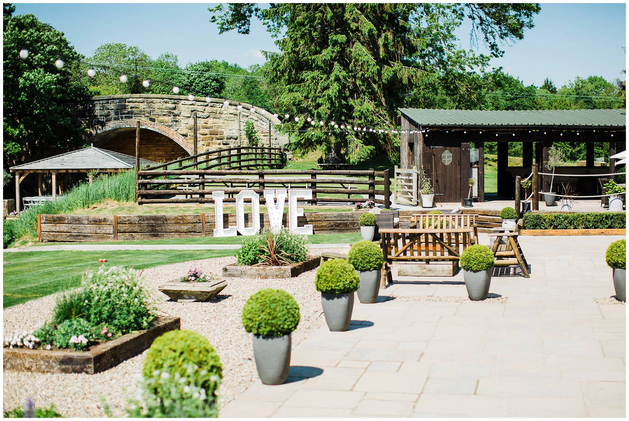 patio area and gardens of tower hill barns. Large light up 'LOVE' letters in the background