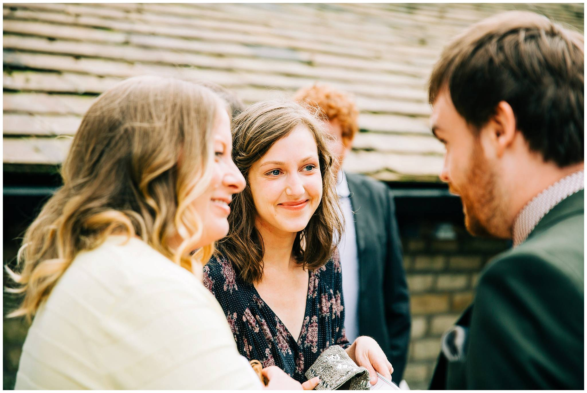 wedding guests smiling and chatting to each other