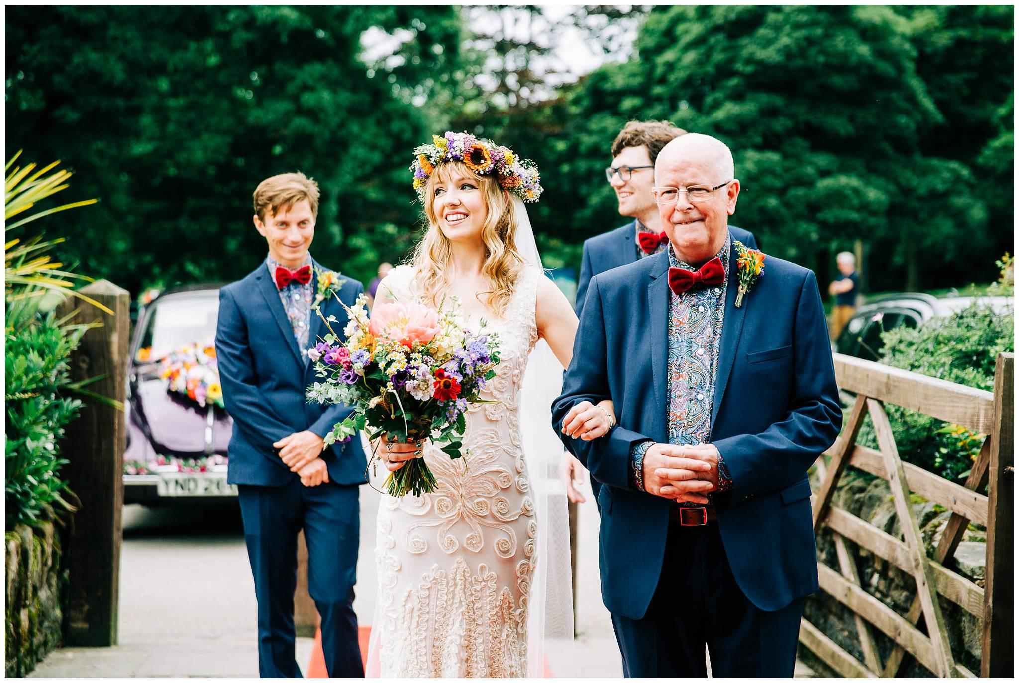 bride starting to walk down aisle smiling