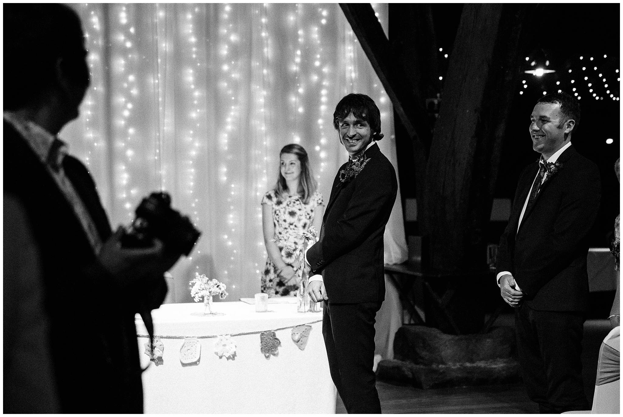 groom looking back at bride with loving smile